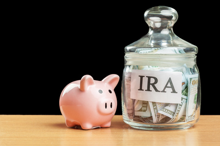 glass jar used for saving US dollar bills and notes for IRA retirement fund Stock Photo - 104831325