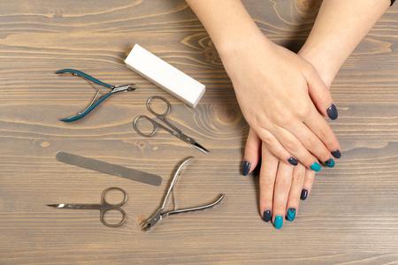 Woman hands receiving a manicure in beauty salon