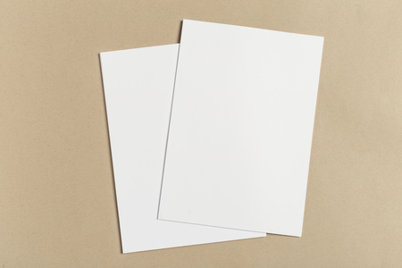 White business card on wooden table. Blank portrait A4. Standard-Bild