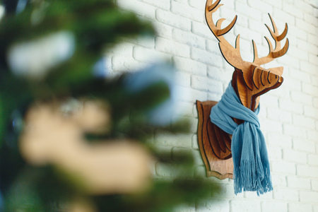 Decorative wooden Christmas elk with a scarf in interior 版權商用圖片