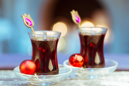 Christmas hot  tea, and light bokeh