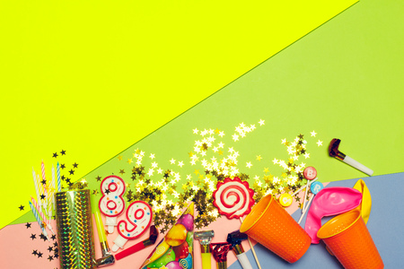 festive party decor and confetti on colored background Stock Photo