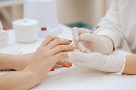 Manicurist does manicure