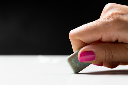 side view of hand with rubber eraser Stock Photo