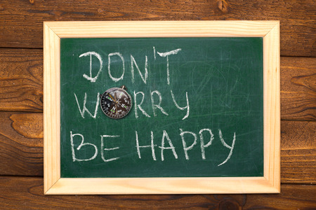 Slate Chalkboard with the text don't worry, be happy 写真素材