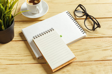 top view. coffee cup with coffee. pen putting on blank notebook. Stock Photo