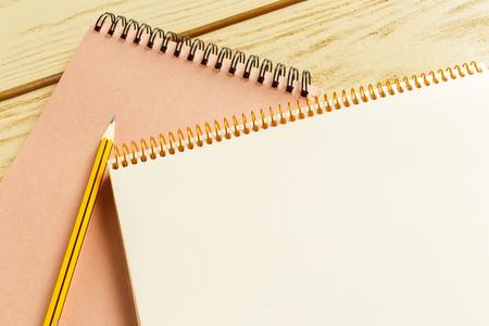 open notepad on wooden background Standard-Bild