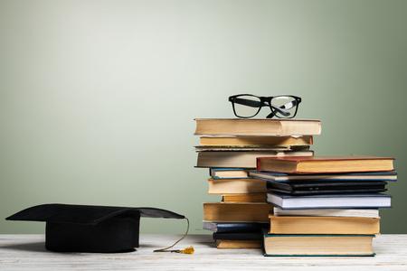 School blackboard with pile of books Stock Photo
