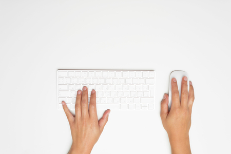 Womans hands on a keyboard