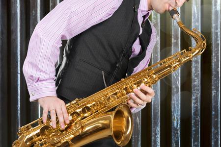 Jazz Saxophone player isolated