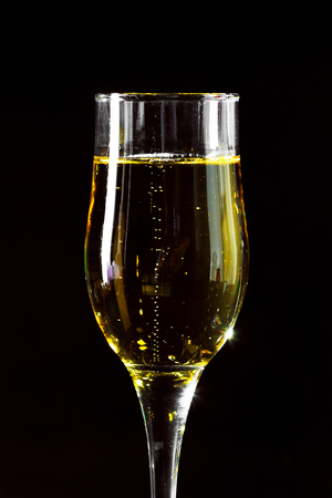 Champagne glass on black background