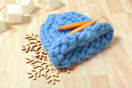 Blue knitted hat in composition Imagens