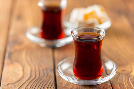 Red tea in turkish glasses on a wooden table Stok Fotoğraf