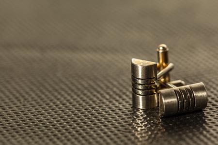 A pair of cufflinks on a dark background