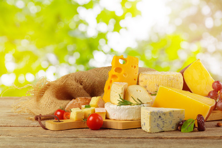 Variety of cheese types composition on wooden board Banco de Imagens