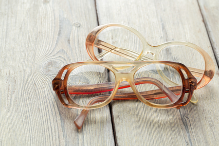eyeglasses on wooden table