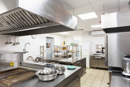 Modern kitchen equipment in a restaurant Imagens