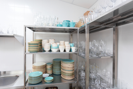 Stacked dishes in a restaurant Stock Photo