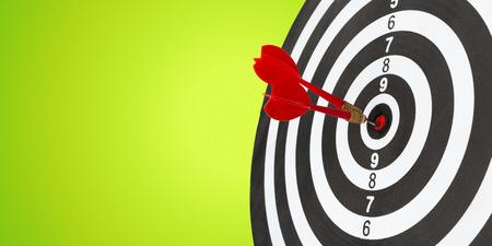 darts arrows in the target center Imagens