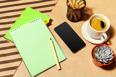 Blank notepad and coffee cup