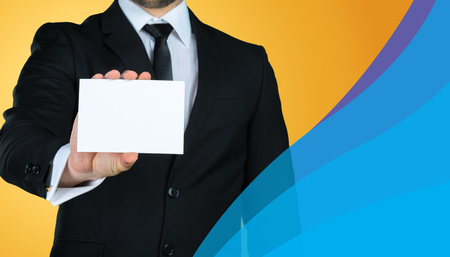 Unrecognizable businessman holding blank piece of paper with copy space