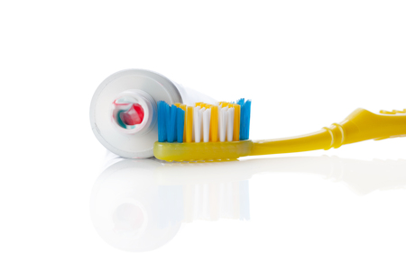 Dental brush and tube with paste isolated on white Stok Fotoğraf