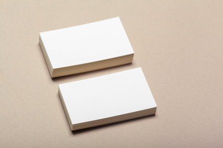 Blank paper pieces for mock up on a beige background Stockfoto