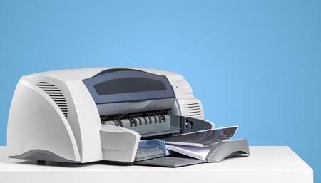 Printer copier machine on a bright colored background