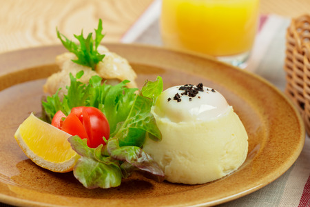 Mashed potatoes with egg yolk and fish slice