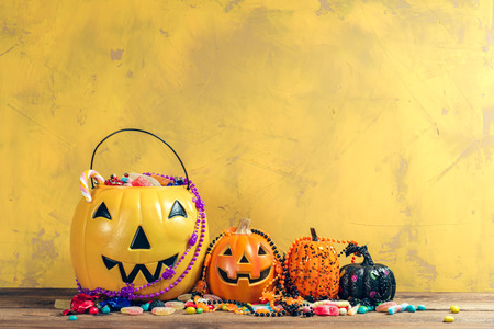 Happy halloween! Pumpkin with candy in the home. Reklamní fotografie