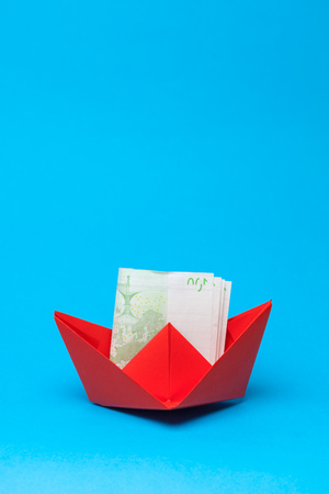 Money banknotes and paper boats. Business concept