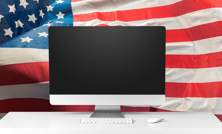US flag and laptop Stock Photo