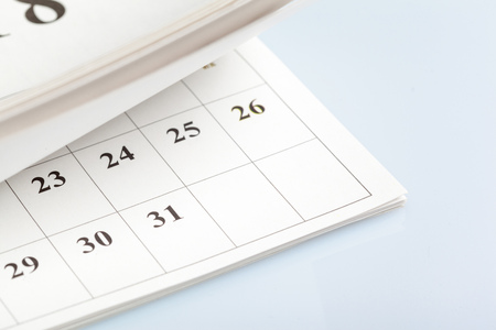 Closeup of dates on calendar page Фото со стока