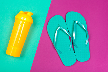Beach flip flop on color background