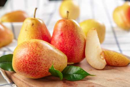 organic pears laying down on a lightly dotted kitchen cloth Stock Photo