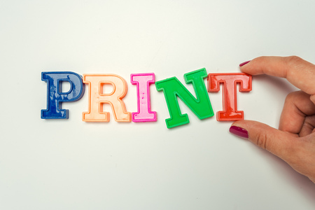 The word PRINT written in plastic colorful letters Stock Photo