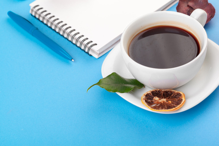 Flat lay photo with notebook , coffee cup on blue Background