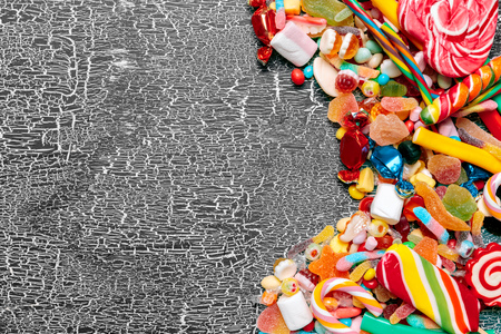 Colorful candies on old background