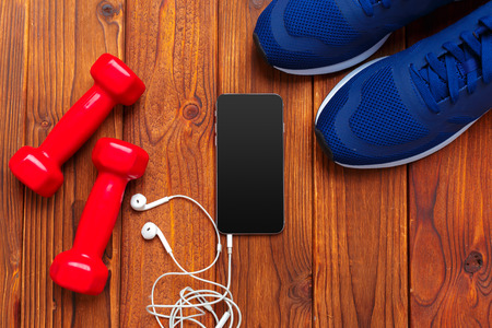Fitness concept with sneakers, dumbbells Stock fotó