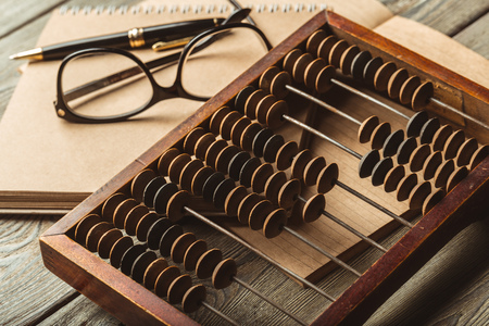 Vintage abacus close up Фото со стока