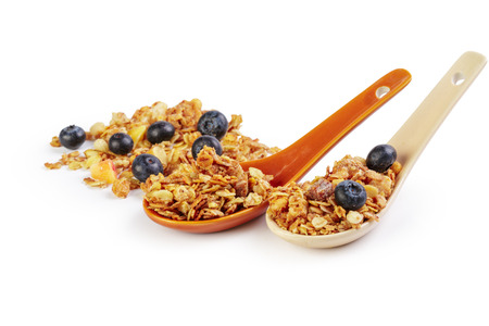 Granola spoon with billberry isolated on white background