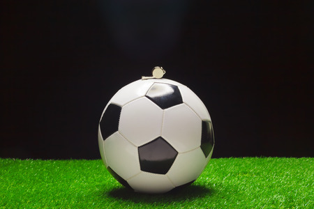 Football ball with whistle Stock Photo