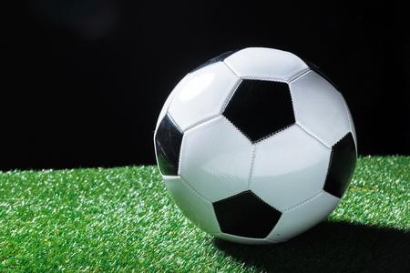Closeup of ball on the green grass.