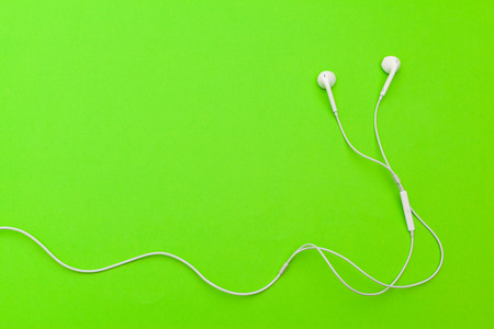 Earphons on color background. Stock Photo