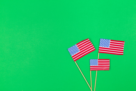 Small paper american flag on wooden stick on bright background Stockfoto