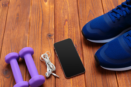 Fitness concept with sneakers, dumbbells Stock Photo