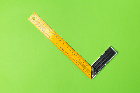 Construction angle ruler on green background top view Stock Photo