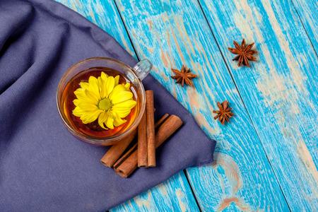 Cup with aromatic hot cinnamon tea on wooden table 版權商用圖片