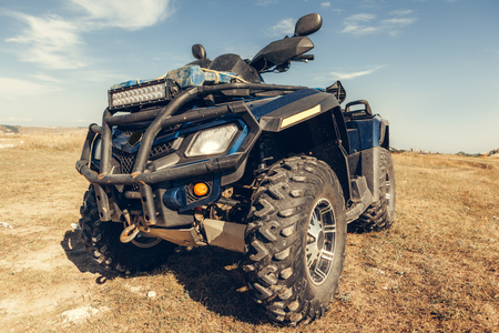 Close-up tail view of ATV quad bike.