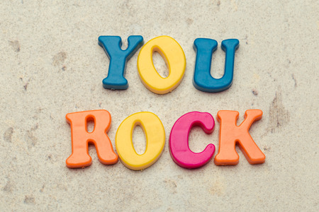 You rock compliment in colorful letters close up